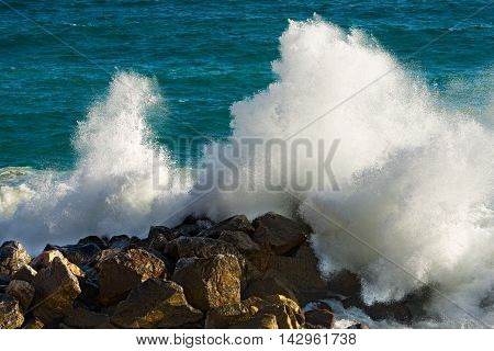 Spray and foam after big wave breaking on water break. Mediterranean Sea Liguria Italy