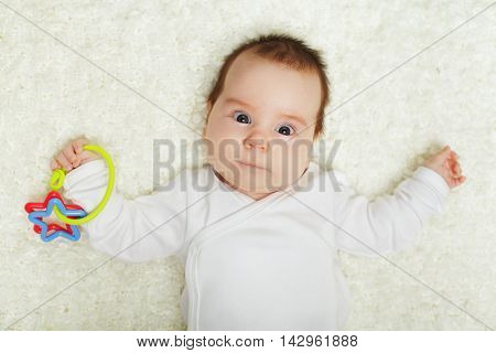 Baby playing with rattle toys and discovery