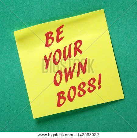 The phrase Be Your Own Boss in red text on a yellow sticky note as an incentive to take control of your business and be an entrepreneur