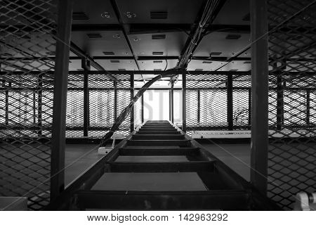 Way up the steel ladder in black.