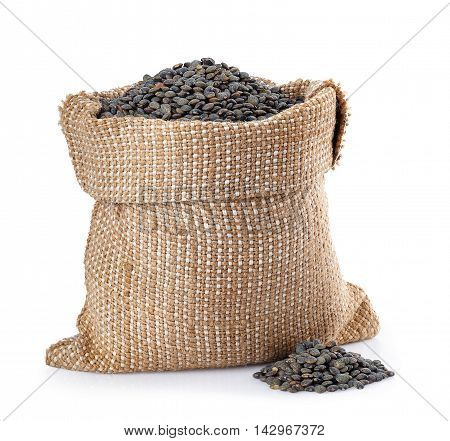 black beluga lentils in burlap bag with heap near isolated on white background. Black beluga lentils. Super food