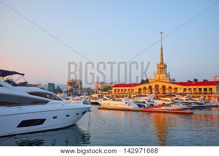 Seaport building with mooring boats at sunset in Sochi, Russia.