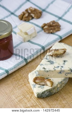 Tasty cheese roquefort with nuts and jam on the towel
