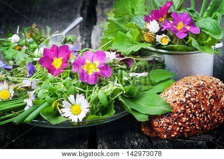 a Spring salad wild herbs edible flowers