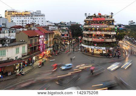 Hanoi, Vietnam - February 23, 2016: Traffic In The Old Quarter Of Hanoi At Sunset In Long Exposure.