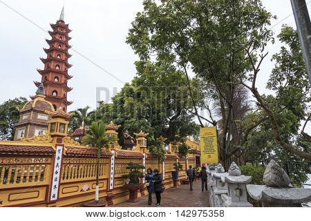 Hanoi, Vietnam - February 23, 2016: Tourists Visiting The Tran Quoc Pagoda In Hanoi, Vietnam