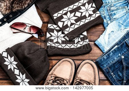 jeans and fashion accessories on wooden boards