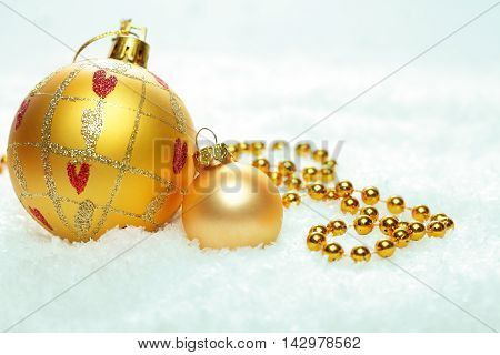Christmas background wit two golden Xmas balls