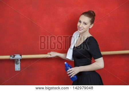 Side View Of Ballerina Holding Water Bottle
