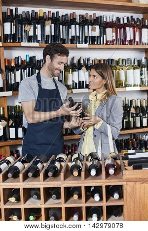 Salesman Showing Wine Bottle To Customer