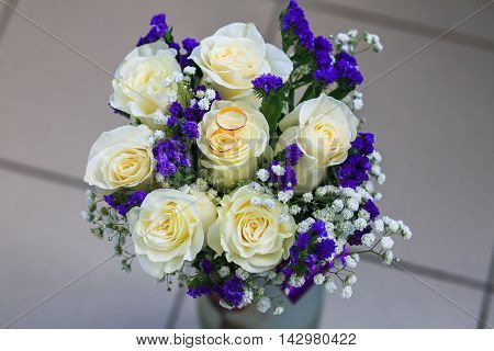 wedding rings on flowers. wedding. newlyweds. gold rings. Lord of the Rings. gold.