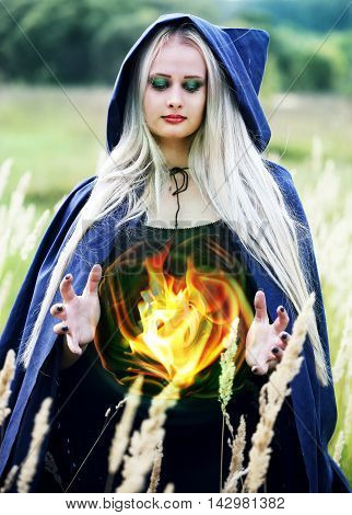 witch holding a fireball in his hand