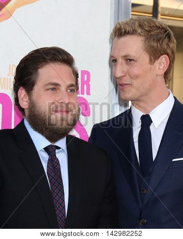 LOS ANGELES - AUG 15:  Jonah Hill, Miles Teller at the War Dogs