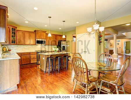 Wooden Kitchen And Dining Room Interior.