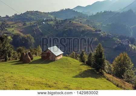 Mountain Landscape In Romania With Wooden Hut. Landscape In Magura Village With The Carpathian Mount
