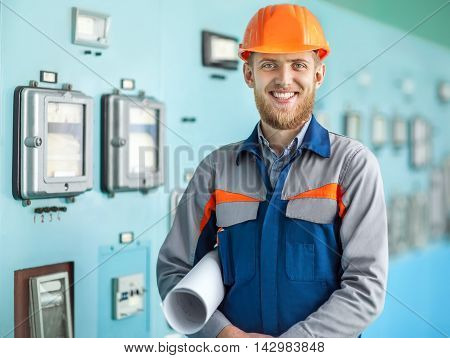 Portrait Of Young Happy Engineer In Control Room