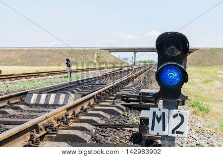 blue semaphore on railroad. soft focus