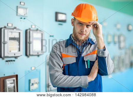 Young Engineer Saluting At Control Room