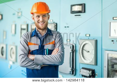 Young Happy Engineer At Control Room