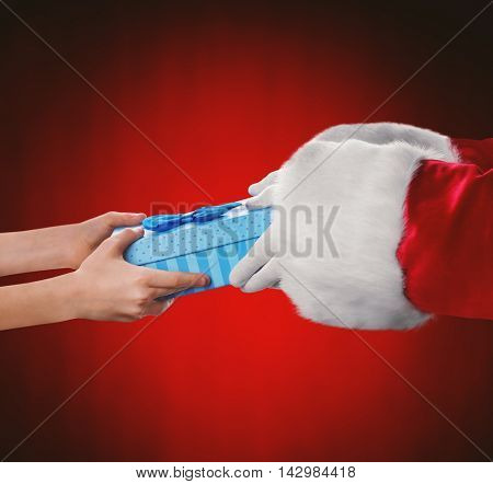 Santa hands give present to kid,on red background