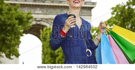 Fashion-monger With Shopping Bags And Cup Of Coffee In Paris