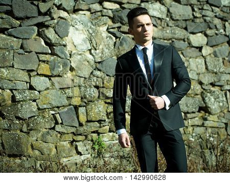 Young Man Wears Suit