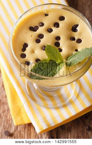 Zabaione Cream With Chocolate Drops Close Up In A Glass. Vertical Top View