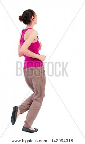 side view of running  woman. beautiful girl in motion. backside view of person.  Rear view people collection. Isolated over white background. dark-skinned girl in a red shirt runs past the frame.