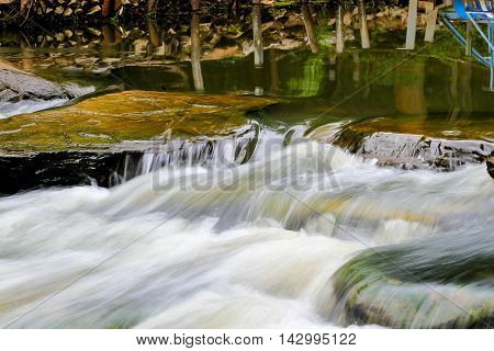 waterfall flow over stone in the river