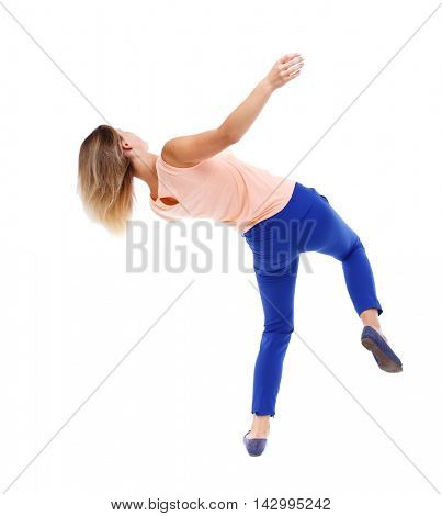 Balancing young woman.  or dodge falling woman. Rear view people collection.  backside view of person.  Isolated over white background. The blonde in a pink t-shirt in freefall