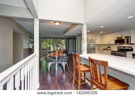 Open Floor Plan. View Of Modern Dining Table Set And Hardwood Floor.