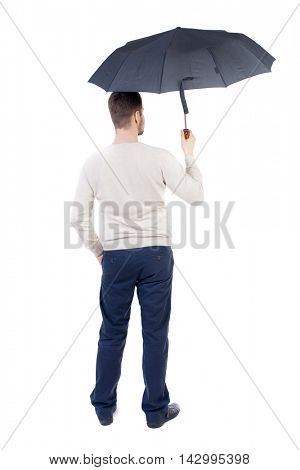 young man in in a white knit sweater under an umbrella. Rear view people collection.  backside view of person.  Isolated over white background. The bearded man in a white warm sweater standing under