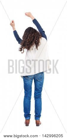 back view of dancing young beautiful  woman. girl  watching. Rear view people collection.  backside view of person.  Isolated over white background. Long-haired girl with curly hair sways in time with