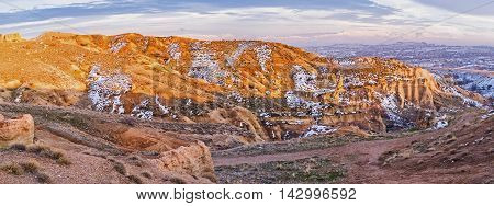 The calm and quiet winter in Cappadocia is the best time to relax in mountains enjoy the loneliness and harmony Red Valley Cappadocia Turkey.