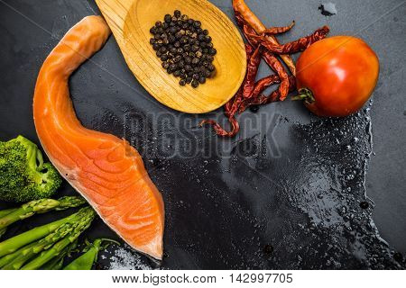 Flat Lay Of Raw Salmon Fillet And Ingredients For Cooking On A Dark Background