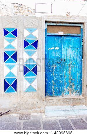 Old door facade in city of Rethymno, Crete, Greece