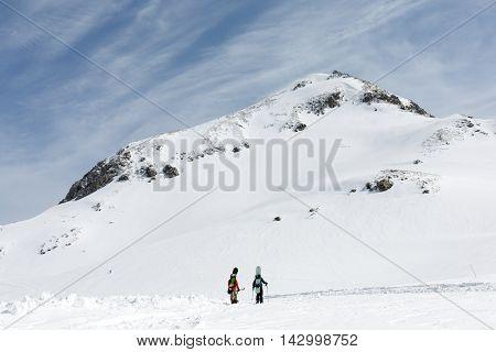 Skiers walking on snow covered mountain ranges Tateyama Japan