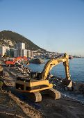picture of jcb  - A red and yellow digger working in Gibraltar - JPG