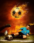image of football field  - Football player in fires flame on the outdoors field - JPG