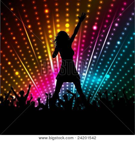 Silhouette of a female singer performing in front of a crowd