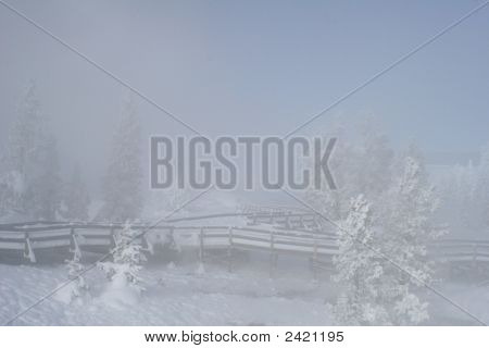 Steamy snow covered wooden walkway