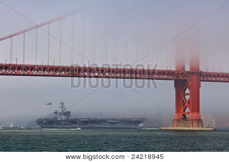 Aircraft Carrier Uss Carl Vinson Passes Under The Golden Gate Bridge
