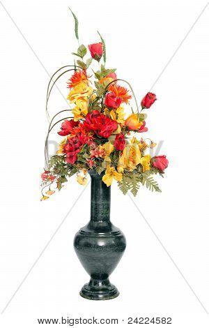 Fall color silk flower arrangement in urn