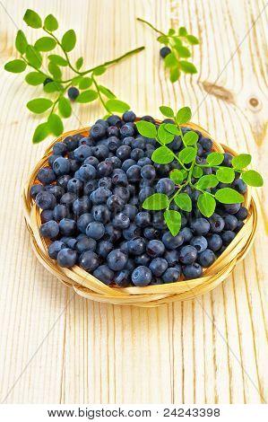 Blueberries In A Wicker Tray On A Blackboard