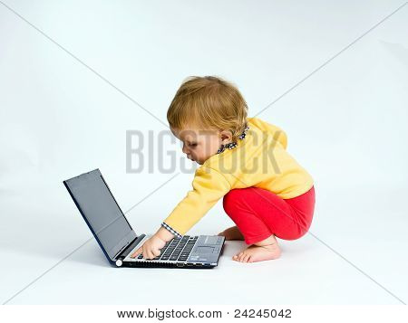 Cute Little Girl With Blue Laptop Isolated On White Background