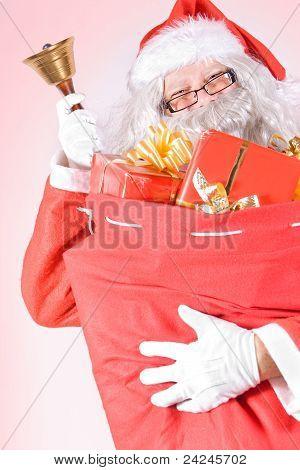 Santa Claus carries a bag