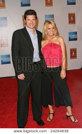 LOS ANGELES - FEB 12: Jessica Simpson, Nick Lachey at the 'A Tribute to Magic Johnson - The official tip-off to NBA All-Star 2004 Entertainment' on February 12, 2004 in Los Angeles, California