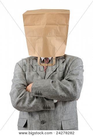 Businessman in ecological paper bag on head and crossed arms.