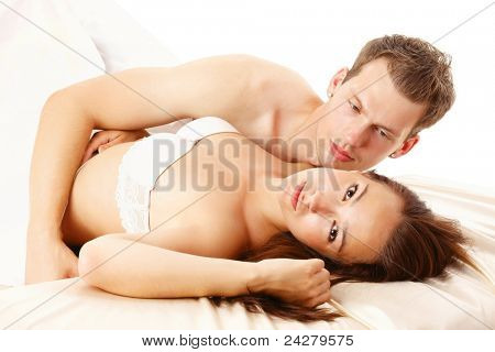 Young unhappy couple in bed
