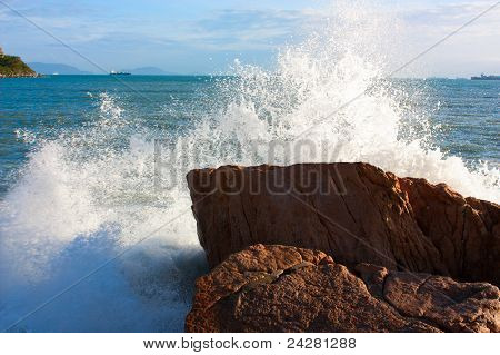 The Waves Breaking On A Stony Beach, Forming A Big Spray